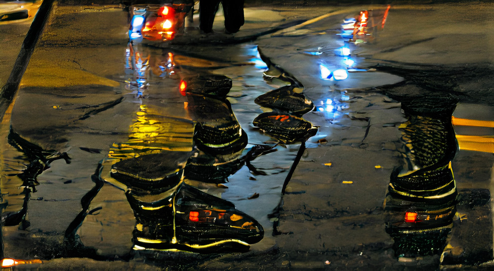 Wet city streets at night with lights in the rain